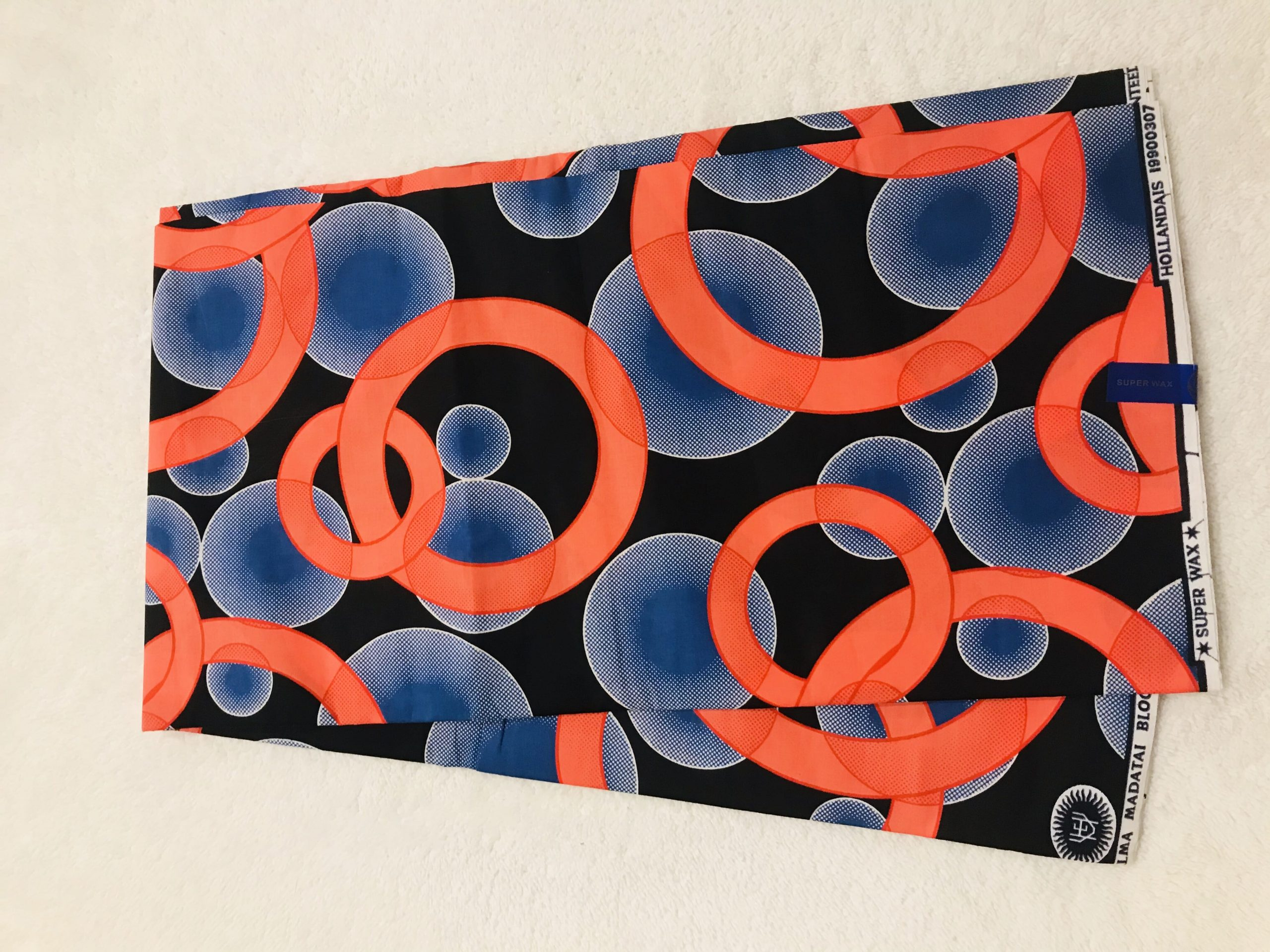 African Wax 6 yards orange blue and black rings and bubles design real African print. Ankanra 100% cotton material.