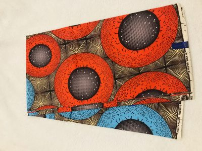 African Wax yards orange tan and blue joint planets ring African print.  Ankanra 100% cotton material